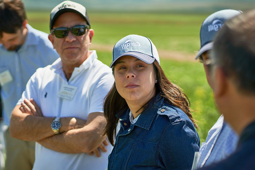 Sustainable grain-based solutions for aquafeed story - woman and men in field wearing Cargill hats